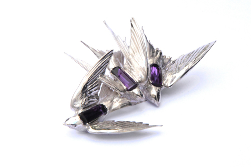 Intercepted Swallow With Amethyst Brooch